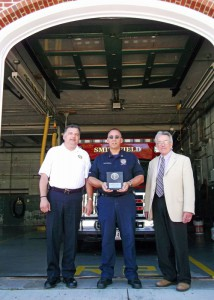 Smithfield Fire Department Captain & Fire Marshal James Waterman was awarded the 2014 Firemark Award, recognizing outstanding commitment to community service. Pictured (L - R) Chief Robert Seltzer - Captain James Waterman - Town Manager Dennis Finlay. — at Smithfield Fire Station 2.